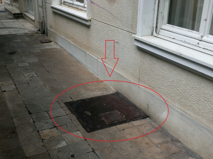 Photo 18: A seemingly innocent lid in the pavement, is the emergency-exit of an old shelter